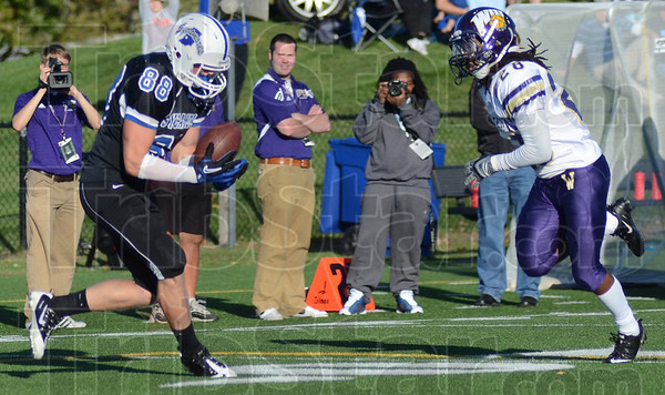 Tribune-Star/Jim Avelis<br /> Six more: Indiana State tight end Michael Mardis hauls in a Ronnie Fouch pass behind Western Illinois defender Ryan Davis for a touchdown.