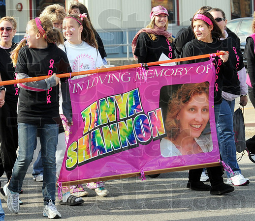 In memory: A group of supporters carry a banner in Memory of Tanya Shannon during Saturday's Race for the Cure.