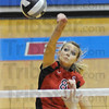 Offensive: South's #8 Brittney Pink powers the ball across the net during Sectional action Saturday morning.