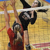Spike: Northview's #13, Shelbi morris spikes the ball during play against Martinsville Saturday.