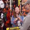 Tribune-Star/Joseph C. Garza<br /> Fun in the costume aisle: Ten-year-old Rosedale resident Rachael Rhoades laughs with her mother, Denise Baker, as she tries on Halloween costumes Thursday at the new Dollar General store in Rosedale. The two were happy they don't have to travel very far to buy necessities now that a Dollar General is in Rosedale.