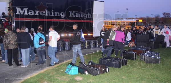 Tribune-Star/Jim Avelis<br /> Back home: Northview band members unload the semi that carried some of their equipment to and from Indianaplis Saturday.