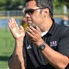 Tribune-Star/Jim Avelis<br /> Approval: Terre Haute South head boy's soccer coach Eric Graves applaudes his team's effort in winning the sectional.