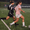 Tribune-Star/Jim Avelis<br /> Downpour: Indiana State's Seyma Erenli brings the ball up the sidelines pressured by Evansville defender Stephanie Thompson in their  Wednesday night matchup.