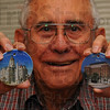 Tribune-Star/Jim Avelis<br /> Fundraiser: The Kiwanis Club of Terre Haute is producing ceramic tiles with a picture of the Vigo County Court House and Terre Haute House on each side. Proceeds from the sale of these 2 3/4 inch tiles will go toward the organization's projects benefiting local children. Here Dick Becker, who took the photographs used to create the tiles holds samples.