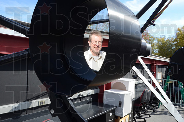 "Tribune-Star/Jim Avelis<br /> Mirrored lens: The five Celestron 14"" telescopes as well as the 20"" one are mirrored. The design allows greater magnification in a shorter instrument. Here Rick Ditteon is reflected in a mirror of the 20"" telescope."