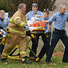 Tribune-Star/Joseph C. Garza<br /> To the hospital: Trans Care and Honey Creek Fire Department personnel transport an individual to an ambulance who was hurt by a falling tree Wednesday at 1967 Oak Ridge Parkway North.