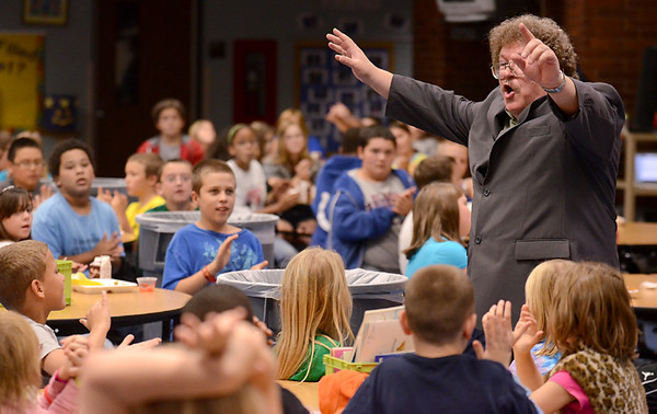 Lunch room symphony: Composer Eric Ewazen leads Deming Elementary fourth and fifth-graders through a rhythm exercise during his presentation Wednesday at the school.