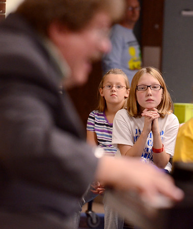 Tribune-Star/Joseph C. Garza<br /> Captivated by the music: Deming Elementary fifth-grader Harley Seeling, center, listens intently as Eric Ewazen, a composer in residence from the Juilliard School of Music, plays the piano during his presentation Wednesday at the school.