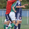 Tribune-Star/Jim Avelis<br /> Sandwiched: Terre Haute North goalkeeper Adam Shamsaie and midfielder Julian Shamsaie play the ball with Vincennes Lincoln's Kyle Richardville caught in between.
