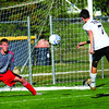 Shot: South's #7, Sam Mimms gets a shot during first half action against Owen Valley's goalkeeper Josh Parker. The shot was high and over the goal.