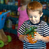Play pineapple:  Kai McAMillin plays with a realistic looking plastic pineapple as he and his sister Millie shop in the pantry of the Children's Museum Monday.