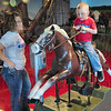 Ride'm cowboy: Four-year-old Landyn Tryon enjoys some time on horseback during his visit to the Children's Museum with his mother Samantha Monday.