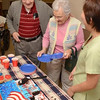 Tribune-Star/Joseph C. Garza<br /> Cake for the new U.S. citizen: Curtis and June Chambers, residents at Westminster Village, congratulate physical therapist Hannah Leong on her new U.S. citizenship before having a piece of cake during a party for Leong Monday at Westminster Village.