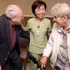 Tribune-Star/Joseph C. Garza<br /> Happy for her: Physical Therapist Hannah Leong, center, is congratulated on her new U.S. citizenship by Westminster Village residents Norbert and Aileen Potteau during a surprise party for Leong Monday at Davis Gardens at Westminster Village.
