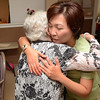 Tribune-Star/Joseph C. Garza<br /> A new American: Westminster Village physical therapist Hannah Leong receives a hug from resident Louise Clark during a party to celebrate Leong's new U.S. citizenship Monday at Davis Gardens at Westminster Village.