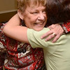 Tribune-Star/Joseph C. Garza<br /> Surprise!: Westminster Village resident Marty Cornelius receives a hug from physical therapist Hannah Leong during a party to celebrate Leong's new U.S. citizenship Monday at Westminster Village. Cornelius, along with staff at the facility, organized the celebration for Leong.