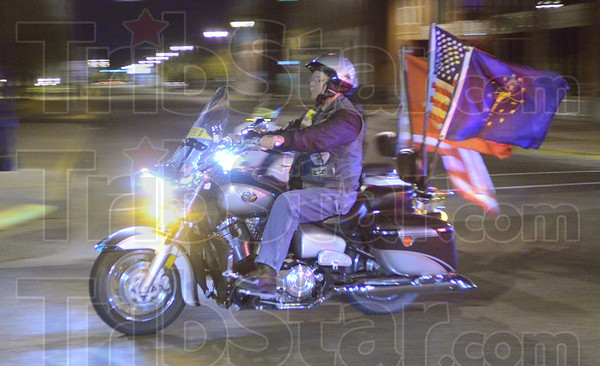 Tribune-Star/Jim Avelis<br /> On guard: About 50 members of the Indiana Patriot Guard escorted the body of Marine Lance Cpl. Thomas John Soeurt home from the Indianapolis airport Tuesday night.