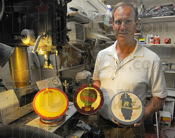 Tribune-Star/Jim Avelis<br /> It's what's inside: Phil Cooper shows three different splait bowling balls, each using a different method of giving the ball an asymetrical weight distribution.
