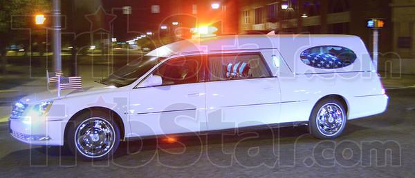 Tribune-Star/Jim Avelis<br /> Homecoming: A hearse bearing the body of Marine Lance Cpl. Thomas John Soeurt rolls down Wabash Avenue Tuesday night.