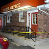 Tribune-Star/Joseph C. Garza<br /> Shooting: Police tape surrounds the entrance of the office of the Royal Inn Monday evening after the hotel's clerk was shot in the chest.