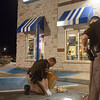 Tribune-Star/Joseph C. Garza<br /> Evidence collection: Vigo County Sheriff's Department Sgt. Clay White collects evidence as Deputy John Newman looks on at the White Castle restaurant at 4340 South U.S. 41 late Monday evening. The restaurant was the scene of a battery and carjacking by three male juveniles who walked away from the Gibault Children's Services.