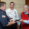 Tribune-Star/Joseph C. Garza<br /> Serving the community: Terre Haute Fire Department firefighter Glen Hall accepts the Exchange Club of Terre Haute's Firefighter of the Year Award from member, Mike Ireland, as Fire Chief Jeff Fisher congratulates him Tuesday at the Holiday Inn.