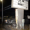 Tribune-Star/Joseph C. Garza<br /> Chase damage: The Auto House Superstore sign, along with two of the car lot's trucks, show damage caused by a truck that was crashed by juveniles from the Gibault Children's Services Monday evening.