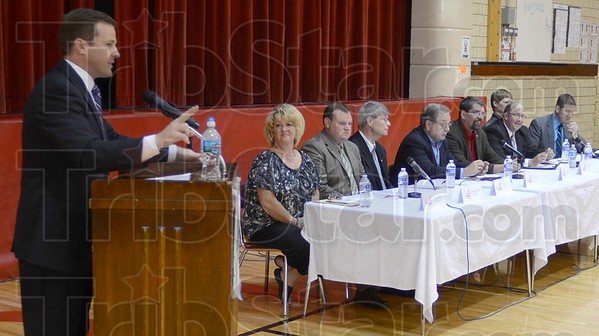 Tribune-Star/Jim Avelis<br /> Rules: Moderator Patrick Fazio recounts the rules for the Tuesday evening City Council debate at Chauncey Rose. Sponsored by the Ryves Neighborhood Association, candidates Amy Auler, Christopher Knew, Robert All, Patrick Ralston, Robert Flott, Norm Loudermilk, Lonnie Moody and John Mullican took part.