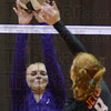 Tribune-Star/Jim Avelis<br /> Stopper: Clay City outside hitter Meeghan Riggs(14) blocks a spike by Jasmine Jeter of the Indiana School for the Deaf in the first game of their regional match.