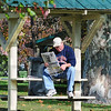 Morning read: New Terre Haute resident Andy Turner takes advantage of the warm morning sun and reads the newspaper in Collett Park Tuesday morning. Andy recently moved to Terre Haute from Detroit, Michigan.