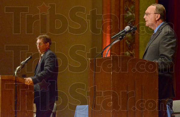 Tribune-Star/Jim Avelis<br /> Challenger: Fred Nation, right, makes his point in Tuesday night's debate while mayor Duke BEnnett bides his time.