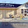 Crash site: City building inspector Randy Readinger (R) surveys the damage to Jimmy John's sandwich shop Tuesday morning.