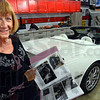 Survivor's vette: Anita Wilhelm looks at her scrapbook showing the evolution of her 2001 Corvette.