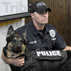 Dog vest: Terre Haute police K-9 officer Ryan Adamson displays his dogs vest during Tuesday's press conference.