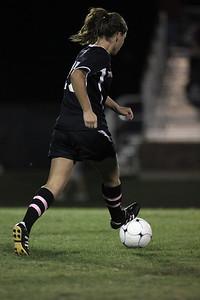 Meagan Reynolds, 17, dribbles the ball.