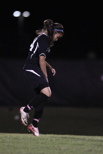 Karyn Latorre, 14, prepares herself by running in place before the second half begins.