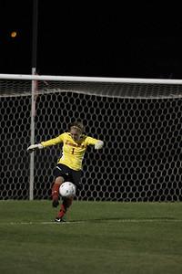 Goalie, Erika Lenns, punts the ball.