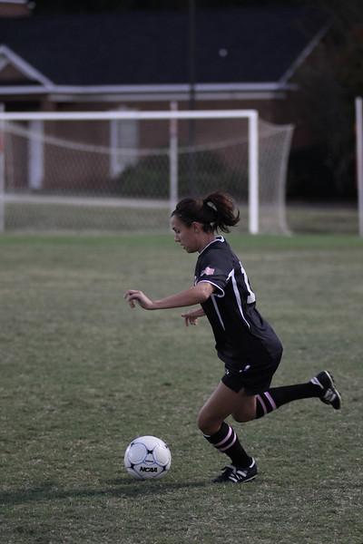 Mackenzie Davis, 13, kicks the ball.