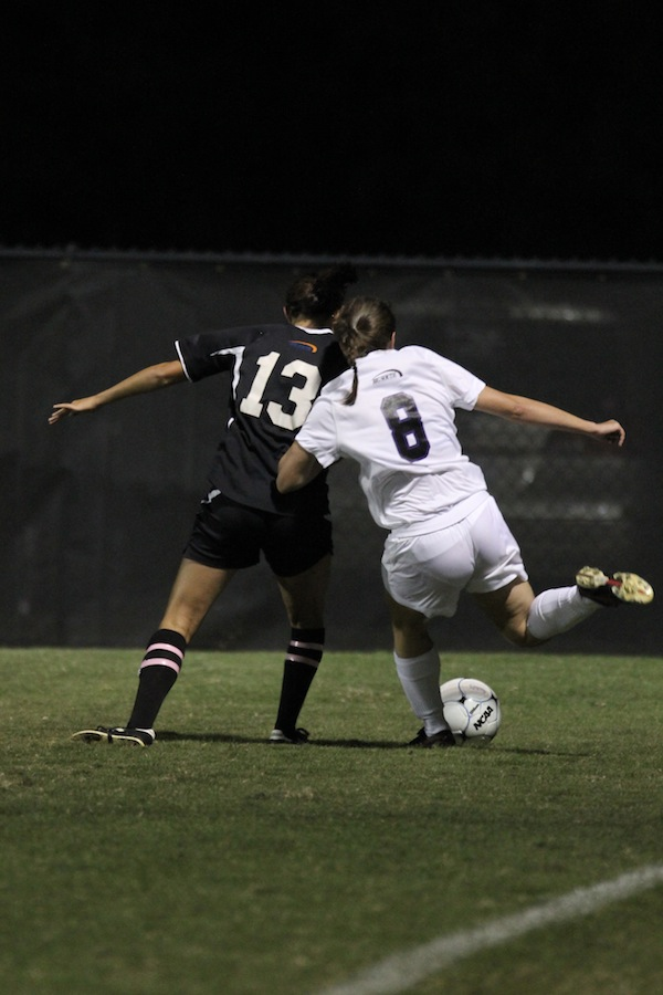 Mackenzie Davis, 13, defends against a High Point player.