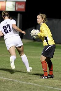 Goalie, Erika Lenns, looks to where she will punt the ball.