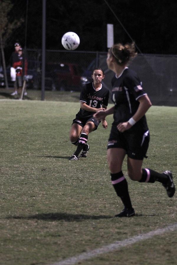 Megan Reimer, 4, looks for a pass from Mackenzie Davis, 13.