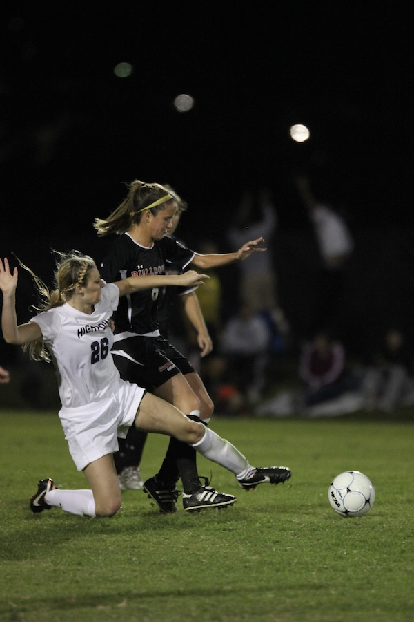 Tina Frost, 6, pushes through a High Point forward to defend the goal.