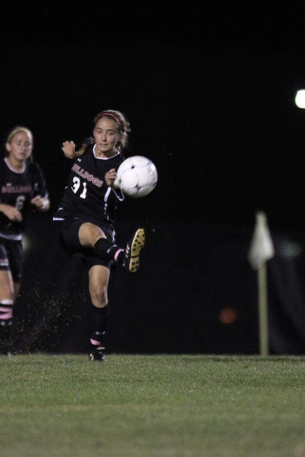 Addison Abee, 31, kicks the ball.
