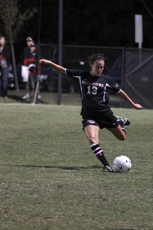 Mackenzie Davis, 13, kicks the ball.