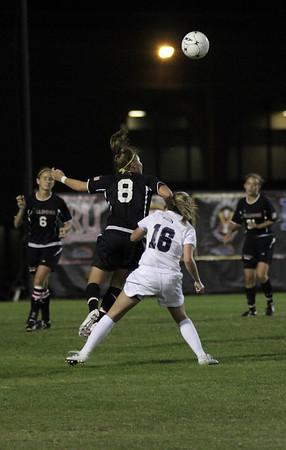 Megan Curan, 8, heads the ball.