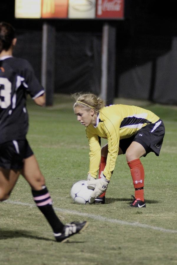 Goalie, Erika Lenns, makes a save.