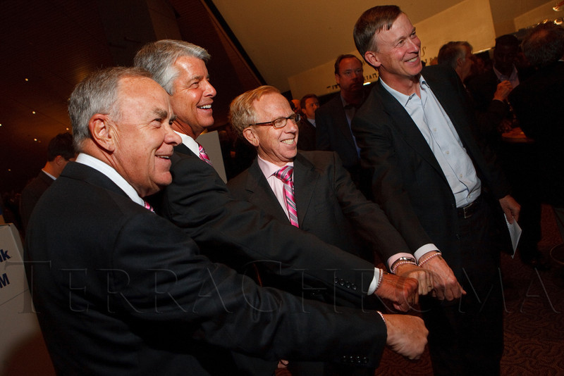 (Denver, Colorado, Oct. 5, 2011)<br /> Ernie Blake, Ed Greene, Bruce Schroffel, and John Hickenlooper show off their pink bracelets.  The 11th annual Men for the Cure, benefiting the University of Colorado Hospital Foundation, at Sports Authority Field at Mile High in Denver, Colorado, on Wednesday, Oct. 5, 2011.<br /> STEVE PETERSON