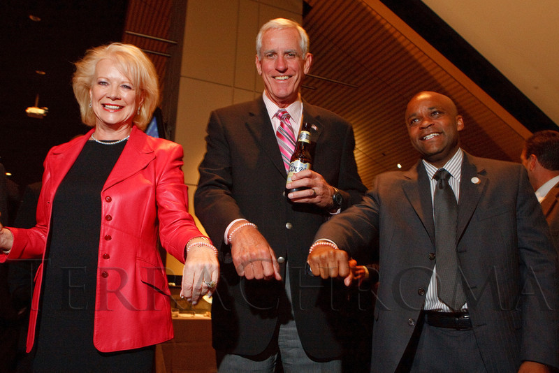 (Denver, Colorado, Oct. 5, 2011)<br /> Sharon Magness Blake, Pete Coors, and Michael Hancock show off their pink bracelets.  The 11th annual Men for the Cure, benefiting the University of Colorado Hospital Foundation, at Sports Authority Field at Mile High in Denver, Colorado, on Wednesday, Oct. 5, 2011.<br /> STEVE PETERSON