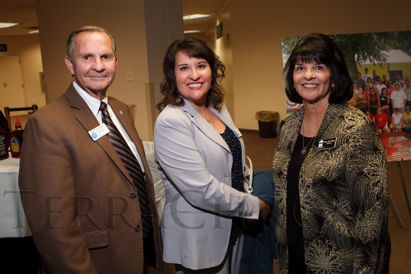 "(Denver, Colorado, Oct. 6, 2011)<br /> Mack Goodman (Thornton Mayor Pro Tem, Susanna Sotelo, and Mary Ann Shing (BRI president).  The Brothers Redevelopment, Inc., 40th anniversary celebration, a fundraiser themed ""Opening Doors,"" at the Denver Merchandise Mart in Denver, Colorado, on Thursday, Oct. 6, 2011.<br /> STEVE PETERSON"